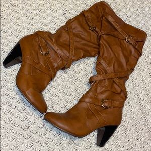 Tall brown boots with buckles